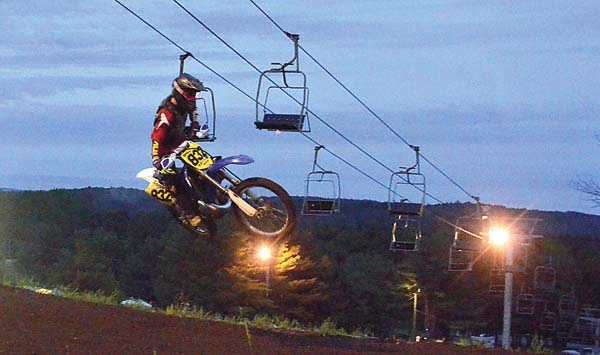 Johnstown's Casey Battisti catches air off the tabletop in the opening moto for the 122-open amateur class during STR/Monster Energy Drink Supercross competition Wednesday night at Royal Mountain Ski Area. (The Leader-Herald/James A. Ellis)