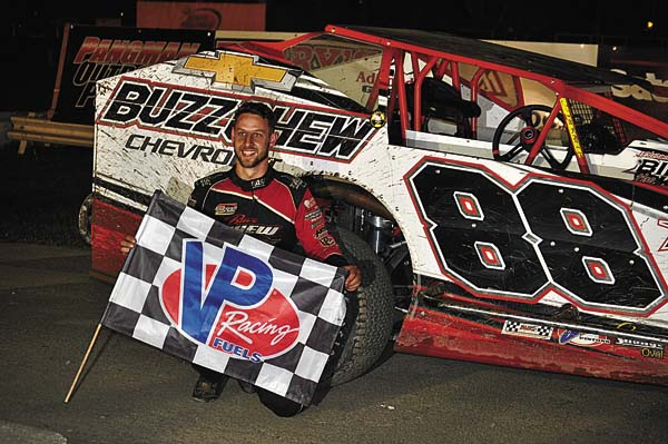 Mike Mahaney poses in Victory Lane after winning the Jack 50, a Tribute to Jumpin' Jack Johnson, Wednesday night at Fonda Speedway. (The Leader-Herald/James A. Ellis)