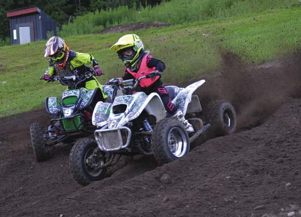 Rian Hynes, left, races with Madeliene Rose in the first mini quad moto during STR/Monster Energy Supercross competition Wednesday at Royal Mountain Ski Area in Caroga Lake. (The Leader-Herald/Paul Wager)