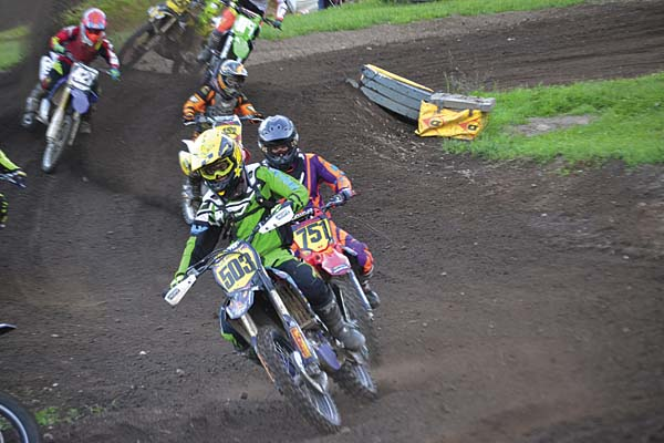 Salvatore Attigiato (503) leads Dylan Larsen (751) in the first 122-250 amateur moto during STR/Monster Energy Supercross competition Wednesday at Royal Mountain Ski Area in Caroga Lake. (The Leader-Herald/Paul Wager)