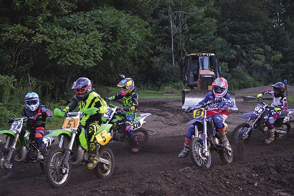 Charles Rose (57), Hunter Hickey (5), Jordan Miller (328), Nicholas Telfer (8) and Caleb Thrasher (5) race together in the first mini 80 12-to-15-year-old moto during STR/Monster Energy Supercross competition Wednesday at Royal Mountain Ski Area in Caroga Lake. (The Leader-Herald/Paul Wager)