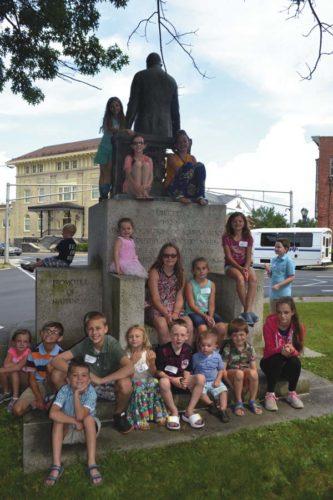 Children and grandchildren of city of Gloversville employees pose on the Littauer Momument on Wednesday.  (The Leader-Herald/Kerry Minor)