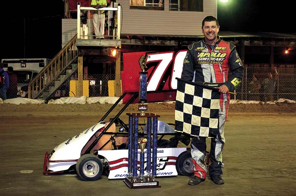 Josh Hohenforst poses in Victory Lane after capturing the benefit 20-lap Winged Cage Kart victory Thursday night at Caroga Creek Speedway.  (The Leader-Herald/James A. Ellis)