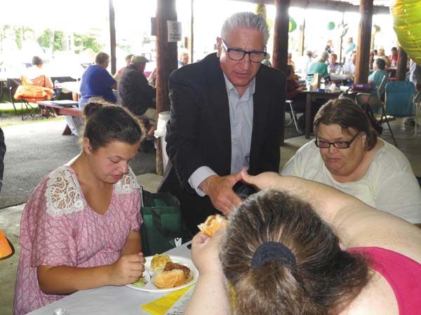 State Sen. James Tedisco, R-Glenville, shakes hands with guests at the Fulton County Office for Aging's 30th Annual Senior Picnic Thursday at the Concordia Club in Gloversville. (The Leader-Herald/Michael Anich)