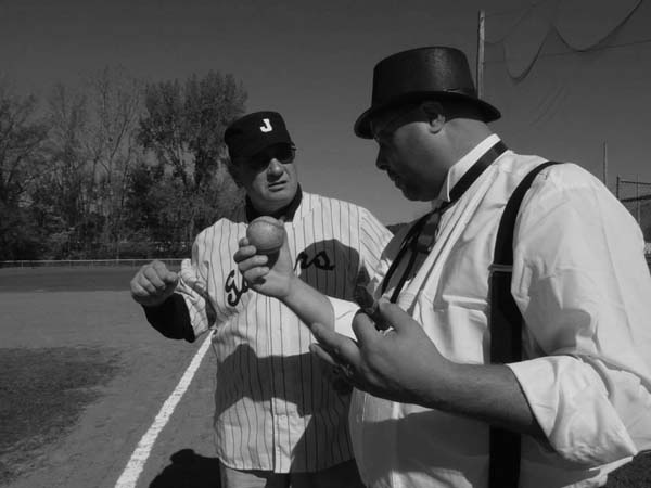 Andy Fusco, left, and Al Busch talk during a previous vintage baseball game at Parkhurst Field. (Photo submitted)