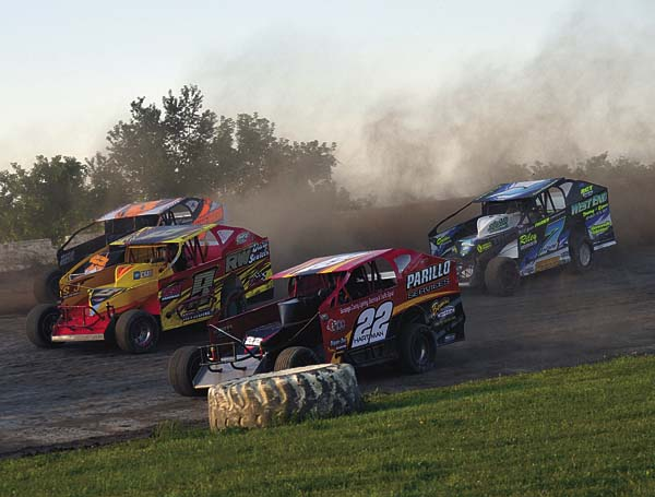 Jim Introne (9), Tim Hartman Jr. (22), David Constantino (7) and Jeremy Pitts race through turns one and two during crate modified heat race action Sunday at Glen Ridge Motorsports Park in Fultonville. Hartman went on to win the 25-lap crate modified feature. (The Leader-Herald/Paul Wager)
