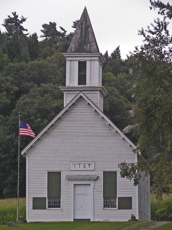 At left is the       historic Indian Castle Church east of Little Falls. Services for the               congregation of St. John's           Reformed Church will be held at the church Aug. 20. (Photo submitted)
