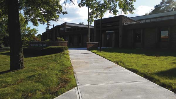 Pictured above is the entrance to City Hall with the new sidewalk installed. (The Leader-Herald/Kerry Minor)