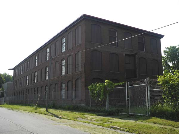 The Grove Street side of the former Diana Knitting Mill in Johnstown is seen Thursday. Townsend Leather of Johnstown, which is expanding into the building, hopes to start some construction by fall. (The Leader-Herald/Michael Anich)