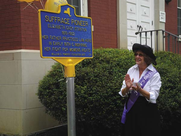Johnstown 3rd Ward Councilwoman Helen Martin on Friday shows off a new state marker she unveiled at the Fulton County Courthouse in Johnstown in honor of Elizabeth Cady Stanton. (The Leader-Herald/Michael Anich)