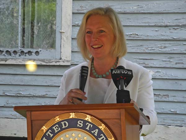 U.S. Sen. Kirsten Gillibrand, D-NY, discusses Johnstown native Elizabeth Cady Stanton during a program Thursday outside the Johnstown Historical Society and Museum in Johnstown. (The Leader-Herald/Michael Anich)