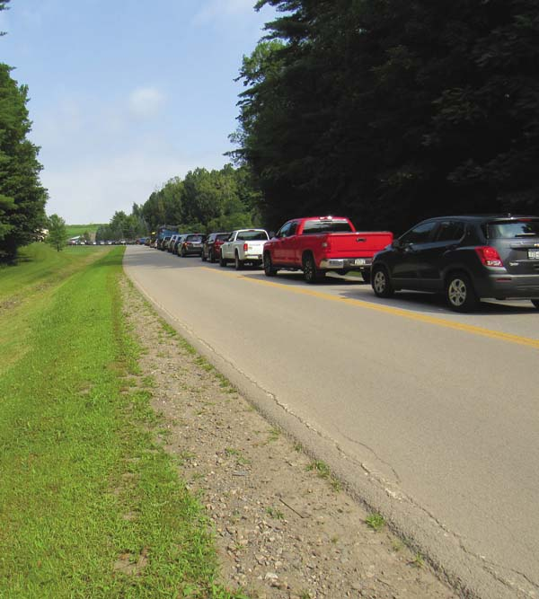 Hundreds of vehicles line up bumper to bumper for a half-mile for the every-two-year Household Hazardous Waste Drop-Off Day Saturday at the Fulton County Solid Waste Department. (The Leader-Herald/Eric Retzlaff)