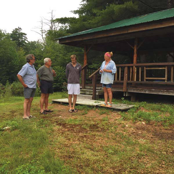 Peter Kiernan, Rick Ruby, Kyle Price and Shawn Cleland in front of Chester's Shed, site of Wednesday's concert benefiting the Caroga Lake Volunteer Fire Company. (Photo submitted)