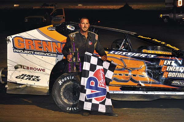 Jeremy Pitts poses in Victory Lane after winning the 25-lap Crate Modified feature Sunday night at Glen Ridge Motorsports Park. (The Leader-Herald/James A. Ellis)