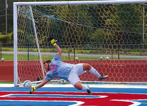 Broadalbin-Perth goalkeeper Ian Halloran makes a diving save during the Patriots practice Tuesday at Broadalbin-Perth High school. (The Leader-Herald/James A. Ellis)