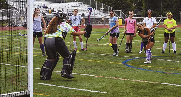 The Leader-Herald/James A. Ellis Goalkeeper Bracie Vocse, left, moves forward and attempts to stop the shot by Rachel Lee during the Johnstown Lady Bills' practice Monday at Knox Field.