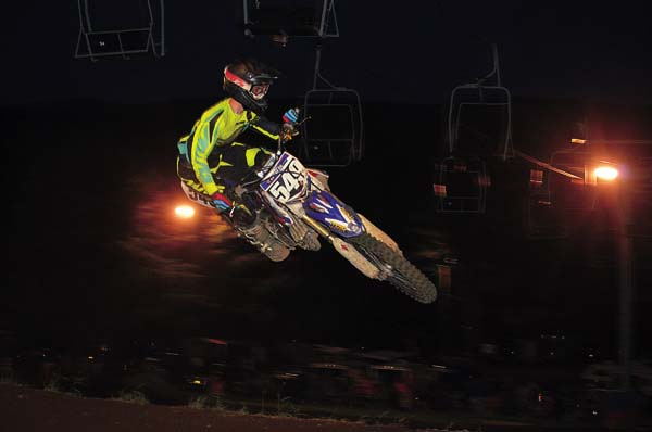 Jared Cordero scrubs off the tabletop jump en route to winning the 122-Open AM division at STR/Monster Supercross Wednesday night at Royal Mountain. (The Leader-Herald/James A. Ellis)