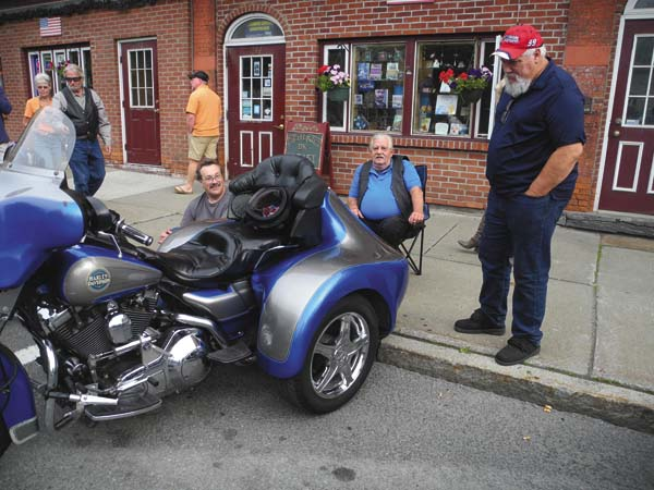 Leon Horton of Perth, standing, checks out the bike of Ron Carter of Palatine Bridge, seated, at the annual Motorcycles on Main Street Show Thursday night in downtown Johnstown. The free event on West Main Street was sponsored by five city businesses, feaured music by Vintage Bros. and had trophies donated by Adirondack Harley-Davidson. (The Leader-Herald/Michael Anich)