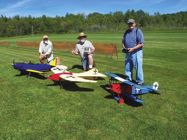 "Mike Spreutels, Ken Hall, and Ron Chizek, pose behind their respective Radio Control model airplanes, in preparation for this weekends air show to benefit the Leader Herald's ""Warm The Children"" program. (Photo submitted)"