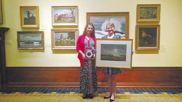 "Hanna Conbeer, director of the Canajoharie Library, left, is shown holding the book ""What is an Eclipse"" by Isaac Asimov, along with Jenna Riley holding Winslow Homer's  1874 watercolor, ""Moonlight."" (Photo submitted)"