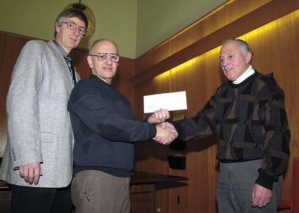 In this Feb. 5, 2002, photo, Gloversville Mayor Frank LaPorta, right, accepts a $10,000 check from Gloversville Housing Authority Chairman Tony Ferraro as GHA Executive Director Dan Towne looks on. The money was from GHA's Section 8 program reserve. (The Leader-Herald/Bill Trojan)  L-R:Dan Towne, Tony Ferraro, Franl La Porta.  INFO. IN BOX