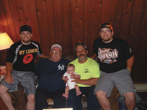 From left, Chris Laska of Perth, father; Chester Laska Jr. of Johnstown, great-grandfather; Joe Laska Sr. of Perth, grandfather, holding Carter James Laska of Perth, who was born June 7; and Joe Laska Jr. of Perth, twin brother of Chris Laska.