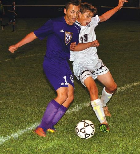 Johnstown's Tyler Benton and Gloversville's Tyler Kemmett (18) work to move each other off the ball during Foothills Council action Monday night at Husky Field in Gloversville. (The Leader-Herald/James A. Ellis)