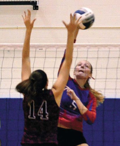 Broadalbin-Perth's Cassy Bown (5) strikes the ball as Gloversville's Abbey Johnson (14) goes up in an effort to block the attempt during a Foothills Council South Division action Sept. 6 at Broadalbin-Perth High School. (The Leader-Herald/James A. Ellis)
