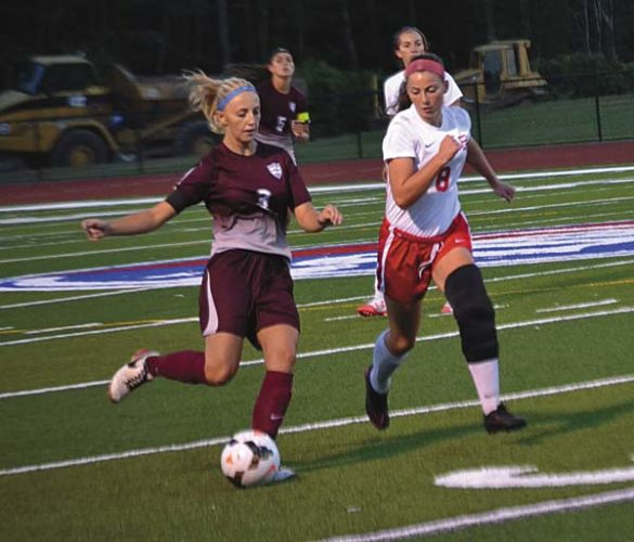 Gloversville's Angel Anderson (3) sends the ball upfield as Broadalbin-Perth's Ava Naple (8) defends during Tuesday's Foothills Council South Division contest at Patriot Field in Broadalbin. (The Leader-Herald/Paul Wager)