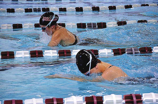 Gloversville-Mayfield's Payton Basini, top, and Fonda-Johnstown's Emma VanGorder battle for position on the breaststroke leg of the 200-yard medley relay during Foothills Council action Tuesday at the Gloversville Middle School pool. (The Leader-Herald/james A. Ellis)