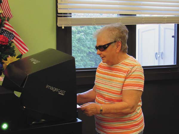 Betty Dalleo of Gloversville casts her ballot in Tuesday's primary at the Kingsboro Towers polling location. (The Leader-Herald/Kerry Minor)