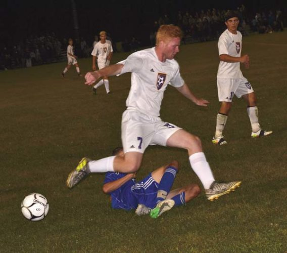 Broadalbin-Perth's Hunter Monks slide tackles the ball from Johnstown's Ben Poitras (7) during Wednesday's Foothills Council South Division contest at Johnstown High School. (The Leader-Herald/Paul Wager)