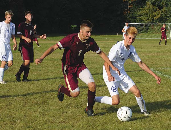 Fonda-Fultonville's Myles Anderson (1) battles for control of the ball with Mayfield's Colby Brandow during a Western Athletic Conference match Wednesday at Mayfield High School. (The Leader-Herald/James A. Ellis)