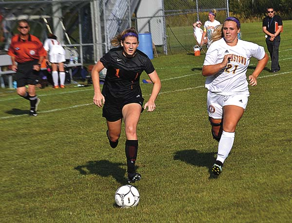 Schuylerville's Emily Vallee (1) and Johnstown's Olivia Weiderman (21) chase down a ball during Thursday's Foothills Council girls soccer contest at Johnstown High School. (The Leader-Herald/James A. Ellis)