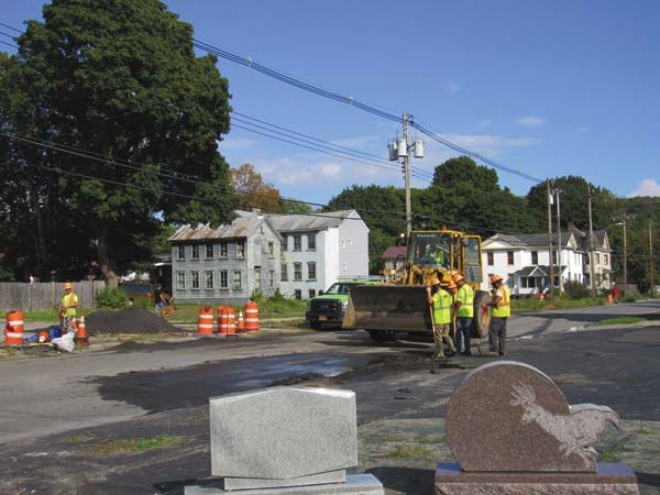Workers from WM. Schultz Construction of Ballston Spa work on East Pine Street Friday afternoon to remove the items that were put in place during the sewer bypass.  (The Leader-Herald/Kerry Minor)