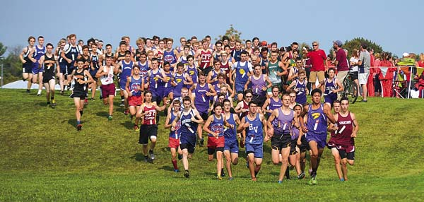 Runners in the Boys Small School Division break over the hill at the start of the 3-mile event at the 40th Annual Fort Plain Cross-Country Invitational Saturday at the Fort Plain Sports Complex. (The Leader-Herald/james A. Ellis)