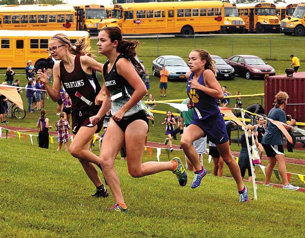Greenville's Tess Fitzmaurice, left, Greenwich's Brynne Wright and Mayfield's Madison Relyea battle for the lead early in the girls Small School division race at the 40th Annual Fort Plain Cross-Country Invitational at the Fort Plain Sports Complex. (The Leader-Herald/James A. Ellis)