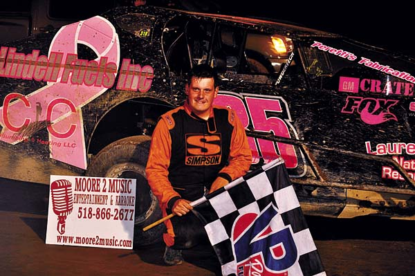 Chris Curtis poses in Victory Lane after claiming the Glen Ridge Motorsports Park 602 Crate Modified track championship Sunday night. (The Leader-Herald/James A. Ellis)
