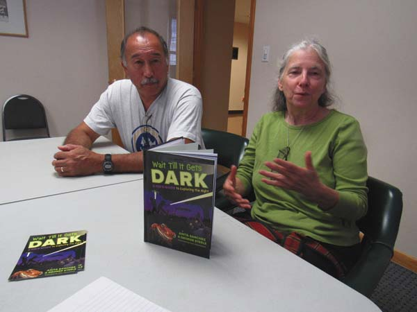 """Husband-wife team from the town of Florida, George Steele and Anita Sanchez, talk about their first joint book, """"Wait Till It Gets Dark: A Kids Guide to Exploring the Night."""" The books helps parents and children to explore and understanding the biology of night creatures. (The Leader-Herald/Eric Retzlaff)"""