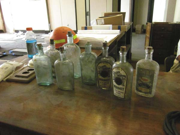 Bottles that were found when lathe and plaster ceilings were removed. (Photo submitted)