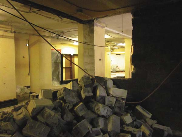 The concrete wall is removed from the former janitor's room in the basement to enlarge the area for the new children's room. (Photo submitted)