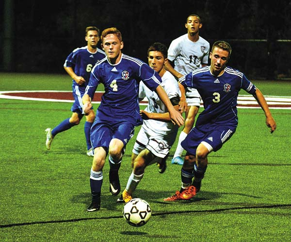 Broadalbin-Perth defenders Ian Dingman (4) and Will Austin (3) double Gloversville's Damian Bruce off the ball during Monday's Foothills Council match at Gloversville High School. (The Leader-Herald/James A. Ellis)