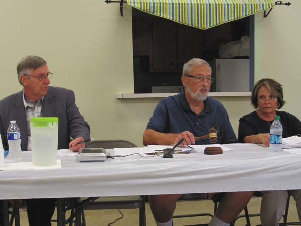 Gloversville Housing Authority Interim Executive Director Daniel Towne, Board of Commissioners President John Castiglione and Commissioner Marcia Weiss are shown at Tuesday's meeting at Dubois Gardens. (The Leader-Herald/Kerry Minor)