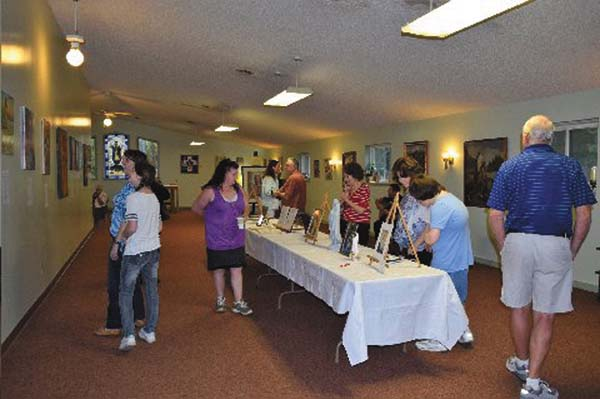 People mingle about at the Kateri Shrine during its first art show and fundraiser last weekend. (Photo submitted)