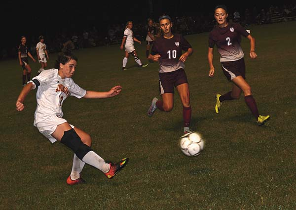 Johnstown's Madison Delgado, left, sends the ball upfield as Gloversville's Michaela Ponticello (10) and Madeleine Jones (2) close in during Tuesday's Foothills Council game at Johnstown High School. (The Leader-Herald/Paul Wager)