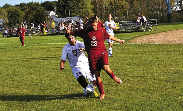 Johnstown's Hank Bobette (24) and Scotia-Glenville's David Currie (23) battle for possession of the ball during Thursday's Foothills Council South Division contest at Johnstown High School. Scotia-Glenville won 2-0. (The Leader-Herald/Paul Wager)