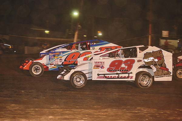 Danny Varin (93) races with Jimmy Phelps during modified action Saturday at Fonda Speedway. (The Leader-Herald/James A. Ellis)