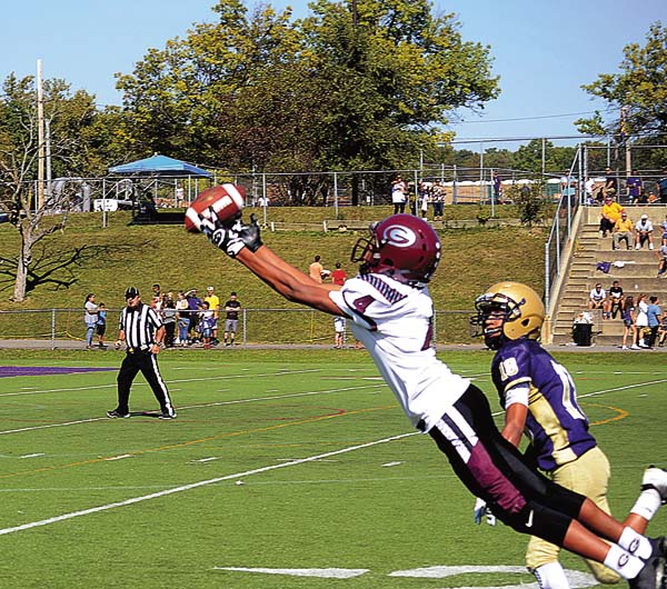Amsterdam's Deanthony Colon (18) looks on as Gloversville's Julien Deumaga (4) stretches out in an attempt to catch a pass during Class A action Saturday afternoon at the Lynch Literacy Academy. (The Leader-Herald/James A. Ellis)