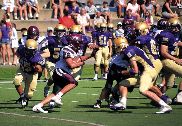Gloversville's Jared Malagisi (25) looks for running room against the Amsterdam Rams during Saturday's Class A contest at the Lynch Literacy Academy. (The Leader-Herald/james A. Ellis)