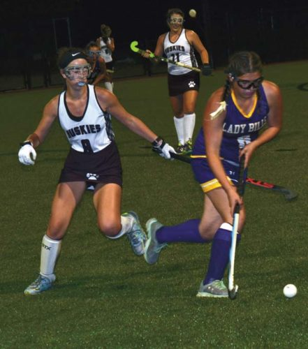 Johnstown's Emma Fiore, right, pushes the ball past Gloversville's Jenna Carbone during Saturday's field hockey game at Gloversville High School. (The Leader-Herald/Paul Wager)